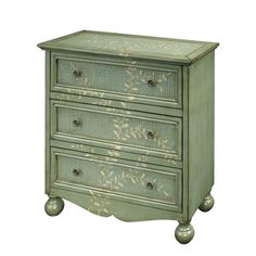 A skirted bottom, decorative hardware, bun feet, and a hand-painted vine motif all contribute to the charm of this chest.