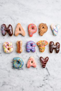 Our Happy Birthday Donuts have received attention from coast to coast in  magazines as well as food blogs. We make these raised donuts fresh each  morning just for you and top them in an assortment of our most popular  flavors, just like their bigger brothers & sisters!  Want the birthday star's name also? Additional letters, just $2 each. To  add a name, please select the appropriate amount of extra letters from the  drop down menu. Once added to your cart you will be prompted to write in…