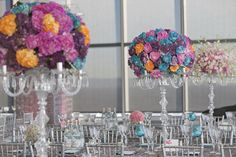 Candy-colored centerpieces sat atop crystal candelabras, and aqua-blue glassware