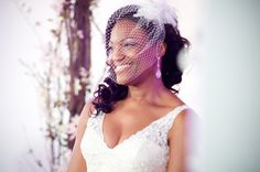 Love the birdcage veil.