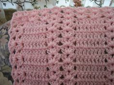 Pink Moscato Double Shell Afghan - Free Pattern - This easy crochet pattern is done in shell stitches and double crochet. Once you know these basic stitches, you'll be crocheting this afghan in no time at all. Complete with a two row lacy edging, this afghan can be made into a crochet baby blanket or even a bedspread.