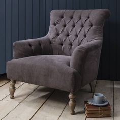 This oversized armchair is perfect for curling up in front of the television or with a good book.With its lovely lines and on-trend button back design, this gorgeous chair is certainly up there in the style stakes. Plush padding with a feather topped seat ensures complete comfort too. It is super soft to the touch and upholstered in a wonderful slate grey brushed cotton fabric which feels like velvet. Lovely weathered wooden legs finish it off beautifully with elegant turned legs at the ...