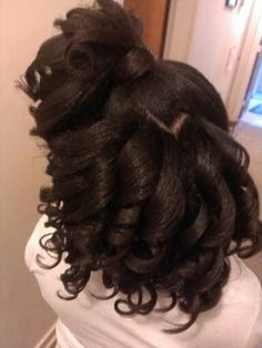 Natural hair, pressed and curled