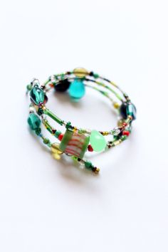 Love these colors. Vintage & Mixed Beads Green, Teal And Orange Memory Wire Bracelet.