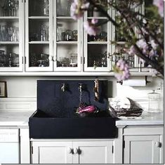 black farmhouse #sink in classic white #kitchen. Roman and Williams office/loft kitchen.