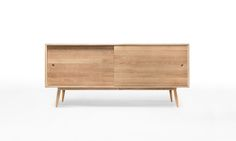 Inspired by the simplicity of vintage design, Oak is characterized by its clean lines and minimal detailing. a sideboard that highlights the warm and natural feeling of oak wood, bringing a beautiful nature element to any living or dining room. Decor, Storage Furniture, Dressing Table Design, Furniture, Oak Wood, Oak Sideboard, Oak, Adjustable Shelving, Wewood