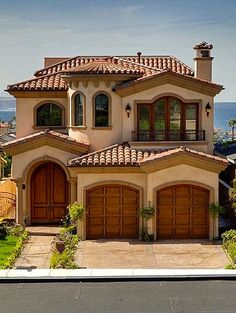 Large and lovely Spanish-style home.  Beautiful front doors.  #homes #homeexteriors homechanneltv.com