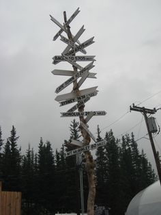 Denali crossroads sign. (AT THE DENALI SALMON BAKE!! Where I worked and suffered and laughed)