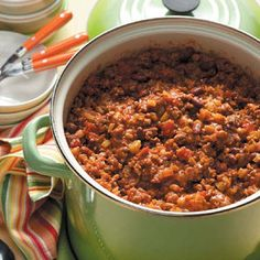 Church Supper Chili...  2 1/2 lb ground beef, browned/drained; 1 (29 oz) tomato sauce, 1 (28 oz) diced tomatoes, 1 (16 oz} kidney beans and 1 (16 oz) pork-n-beans; 1 small onion, 1 green pepper, 3/4 cup celery, all finely chopped; 1 1/2 tsp chili powder; 1/2 tsp salt; 1/3 tsp each cumin, paprika, cayenne and pepper; 1 bay leaf.Combine all  ingredients in large kettle; cover and cook over medium heat for 2-3 hours. Discard bay leaf.  Serves 8-10