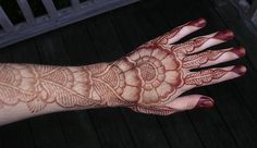 Henna hand... like the way the finger tips & nails were incorporated into the design here.