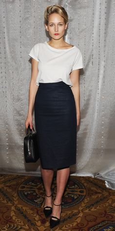A pencil skirt may seem like the last thing you would pair with a T-shirt, but, as Leelee Sobieski proves, it's a no-fuss option for an early evening cocktail or dinner date. Look for a darker skirt to counter your plain white tee.