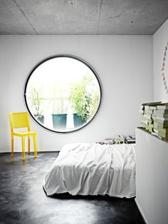 Round window- make it by enough to lie in. Take a look at www.naturalbedcompany.co.uk for solid wood beds, white cotton bedding and soft mohair throws...