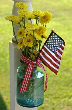 4th of July ideas ~ Mason Jar & flag with red gingham ribbon and simple yellow flowers ~ so cute, could take out the flag and use this idea year round! ~ From Steadmans' Corner