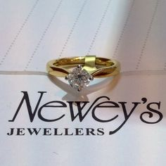 An 18ct yellow gold band is the perfect way to show off this compass-set 0.70ct F colour SI clarity brilliant round diamond! www.neweysjewellers.co.uk