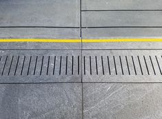Abstract urban gray sidewalk pattern with yellow stripe. Free photo download. Abstract background texture from Sherrie Thai of Shaireproductions.