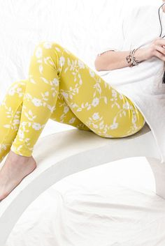 e062312f930a White floral prints on yellow-lime leggings. 95% polyester, 5% spandex