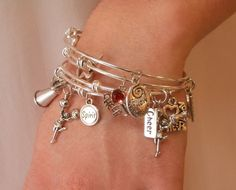 Are you looking for the perfect cheerleading gift? We are loving these GORGEOUS Cheerleading Bracelets from TheCheerleadingShop.com. Order yours today and you can even CUSTOMIZE them!