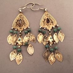 Tajikistan | Earrings; silver, cut emeralds, gilt, cut garnets | Sold