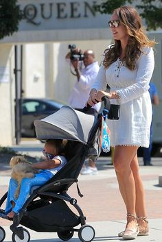 Tamara Ecclestone wearing Valentino Rockstud Flat Espadrilles and Babyzen Yoyo 6…