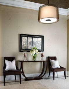 """Nice for your Foyer .Two brown chairs with the right color pillows a""""U"""" table place your candle holder or a plant the  mirror on wall gives this a very nice look.[]"""