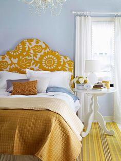 I like the serene walls mixed with the bright headboard