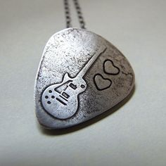 Guitar pick necklace. I want this!!