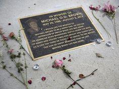 A memorial for Michael Brown is seen in a sidewalk