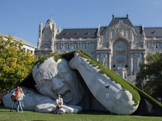 Budapest | There's a Giant in Budapest, in front of the luxury Four Seasons Hotel Gresham Palace Budapest. Photo courtesy Attila Volgyi Xinhua News Agency/Newscom. see on Fb https://www.facebook.com/BudapestPocketGuide/photos/a.133754320021168.26142.126597814070152/798180210245239/?type=1&theater #Budapest #travel #Travel2Budapest