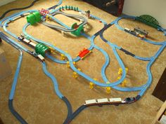the conductor can move trains from one track to another, by use of a convenient switch track.