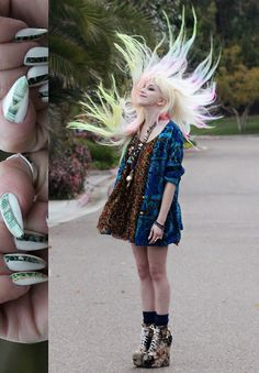 cool! + I think her nails have bits of US $ notes stuck to them...