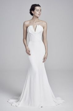 Suzanne Neville 2019 wedding dress with a strapless crumb catcher split neckline. It is a beautiful minimal sheath wedding dress (carmella) with an elegant sweep train. Girls Bridesmaid Dresses, Affordable Bridesmaid Dresses, Wedding Dresses For Girls, Designer Wedding Dresses, Bridal Dresses, Girls Dresses, Dresses Uk, Simple Elegant Wedding Dress, Yellow Wedding Dress