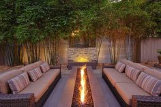 Gorgeous outdoor firepit, furniture and water feature, offered lots of privacy by a living wall of bamboo!Gorgeous outdoor firepit, furniture and water feature, offered lots of privacy by a living wall of bamboo! Fire Pit Backyard, Backyard Patio, Backyard Landscaping, Backyard Seating, Landscaping Ideas, Outdoor Seating, Outdoor Privacy, Patio Fire Pits, Fire Pit Near Pool