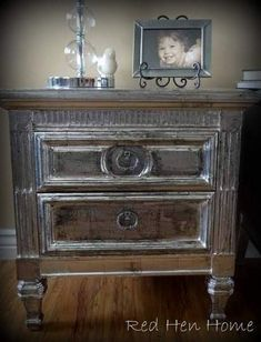 A nightstand that features a solid construction with