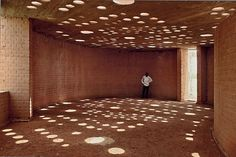 Using bricks made from local clay and embedded clay pots over the roof, Diébédo Francis Kéré from Gando, designed an ingenious and yet simple architecture for a library in Burkina Faso (Africa)  See also  https://www.ted.com/talks/diebedo_francis_kere_how_to_build_with_clay_and_community