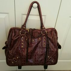 Burgundy patent leather croc carry-on/laptop bag Here is a like new airline certified carry-on with lots pockets. This has a retractable handle and recessed wheels. Long shoulder straps allow this to be carried as a shoulder tote as well. Features brass hardware and patent leather croc print and a separate cushioned section for your laptop. Only used 3xs. MMS Executive  Bags Travel Bags