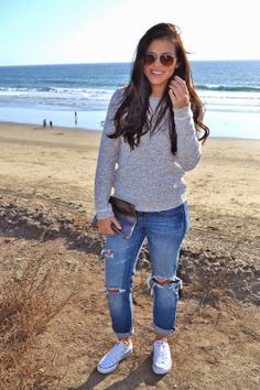 white converse, ripped jeans, grey sweater