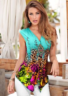 A colorful embellishment holds this beautiful printed top together! Venus bright animal print top.