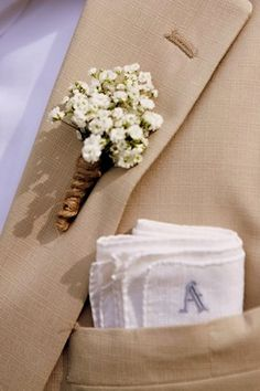 Baby's Breath Boutonniere secured with twin. Using fresh or dried Baby's Breath flowers, gather a few stems together and cut to size. Secure the stems with an elastic band or similar. Wound twine or burlap string around the stems of the flowers to complete the look.