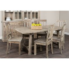 Add rustic and country charm to your Dining room with this table. The distressed finish and aged hardware add to the welcoming aura of any space.