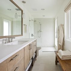nice color scheme: wood, white counters, light beige floors, white tile in shower