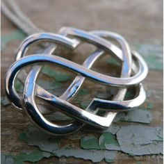 Discover this Celtic Knot Pendant in the form of two hearts entwined and bound by the symbol of infinity. Celtic Knot Necklace, Irish Jewelry, Two Hearts, Jewelry Necklaces, Bracelets, Cross Pendant, Silver Rings, Pendants, Hang Tags