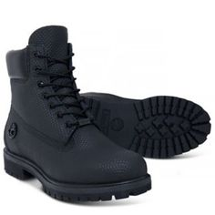 Timberland® black leather boots.