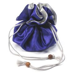 Jewelry Pouch, Drawstring Closure, Satin Purple/Silver, Approx. 4 Diameter x 3H by Bags-n-More. $9.99. A great way to store your jewelry and personal items, such as rings, earrings, watches, etc. while traveling or for everyday use. This jewelry pouch has 8 interior pockets and a drawstring closure with two wood bead ends.  Handcrafted in Thailand.  Gift-wrap available.