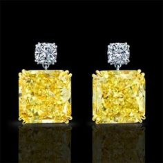 To Die For! Fancy Intense Yellow Radiant Cut Diamond Drop Earrings.By Norman Silverman.