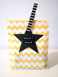 ❤︎ the black and white striped peg holding the black star gift tag to the yellow chevron bag - kahden vaiheilla
