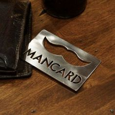 Love this Mancard bottle opener as a groomsman gift.