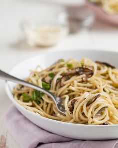 Easy Mushroom and Garlic Spaghetti Recipe. This hearty, healthy vegetarian dish is perfect if you're looking for meatless monday recipes even meat eaters will love! This homemade pasta dinner starts with sauteed mushrooms and ends with tons of umami flavor.