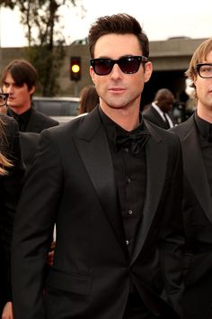 Adam Levine dons black on black and shades to boot Rhianna stuns in custom Alaia at the 55th #GrammyAwards #RedCarpet #ClassicStyle