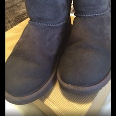 Girls UGG Boots Size 2. Worn very few times. Inside of boots are very clean, some water damage as shown in first pic, due to wearing in snow, but can be cleaned with suede cleaner. Besides that, these boots are other wise very clean and will last a while. Original box included. UGG Shoes