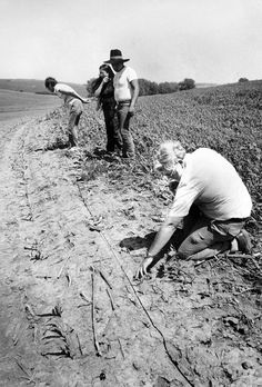 Roger Sharpe, right, a UNO associate professor of biology, was called to an area west of Macy, Nebraska, to examine what some area residents thought might be Bigfoot prints in June 1986. Macy Police Officer Milton Miller wrote in his report that the prints were 15 inches long, with the middle part of the foot spanning 3½ inches and the toes spanning 7½ inches. The tracks, which had been blurred by sun, wind and rain, didn't yield any conclusive information. THE WORLD-HERALD